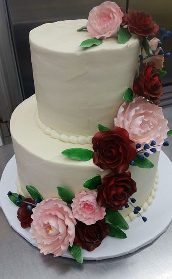 Wedding Cake With Pink and Red Flowers